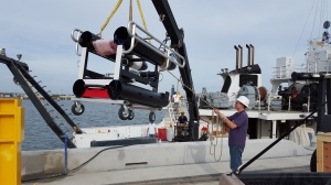 USM researcher Kevin Martin helps to lower the ISIIS onto the Pt. Sur