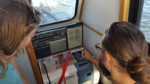 Adam Boyette runs the FlowCam to characterize the phytoplankton community and monitor the HAB